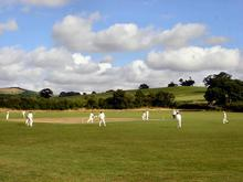 Click for a larger image of St James in the shadow of Win Green